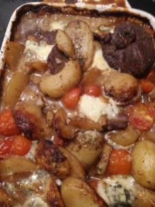 Baked lamb with stilton and potatoes