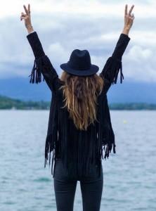 Black fringed suede jacket black fedora skinny jeans