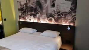 Kyriad Gare Perrache hotel bedroom