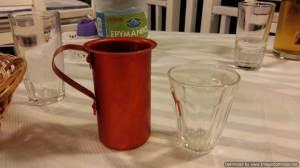Wine in a metal jug