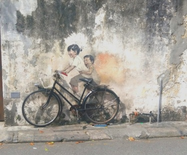 Children bike street art Armenian Street