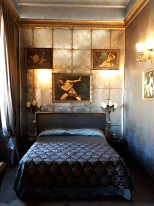 Bedroom interior at Antica Dimora del Cinque Lune Rome