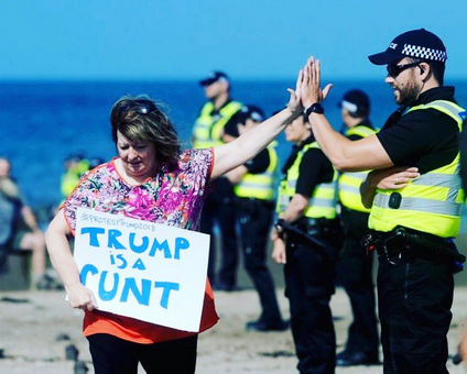 Trump protestor high fives policeman